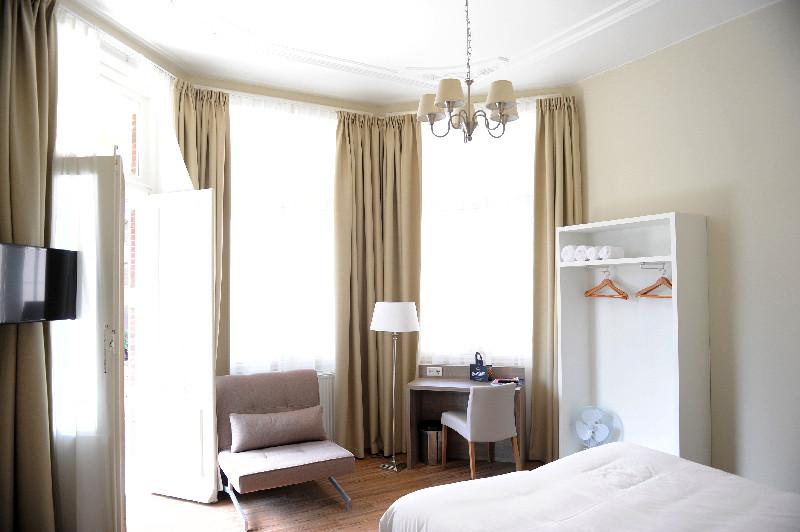 Klare Linien und helle Farben prägen die Zimmer im Hotel Andante, einer Villa von 1886.